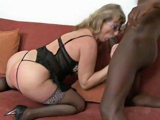 Voluptuous Granny With Glasses Riding A Big Black Cock