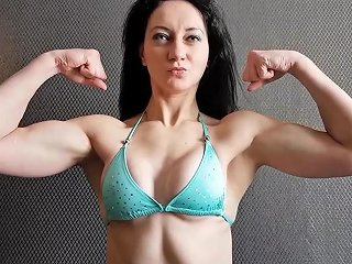 Strong Brunette Flexing Biceps