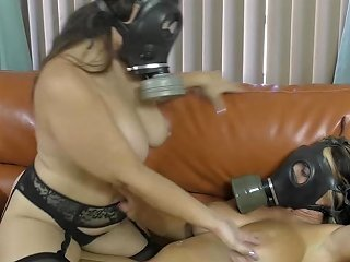 Two Lesbians Being Playful In Gasmasks