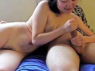 Korean Cum Whore Justine Lim Stroking A White Cock