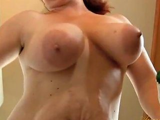 Naked Freckled Housewife Cleaning The Kitchen