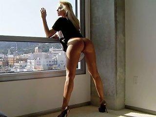 Leggy Blonde Sandy Fucks Herself Near The Window