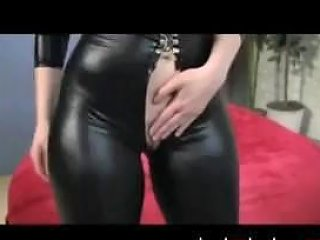 Busty Redhead In Leather Suit Gets Kinky And Talks Dirty