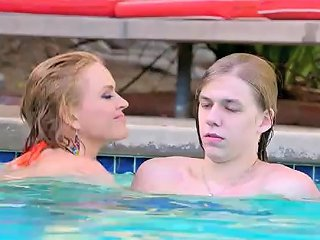 Krissy Lynn Gives The Lucky Young Man An Underwater Handjob