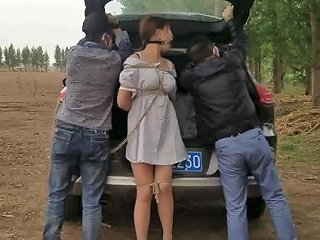 Chinese Tied Up In A Forest